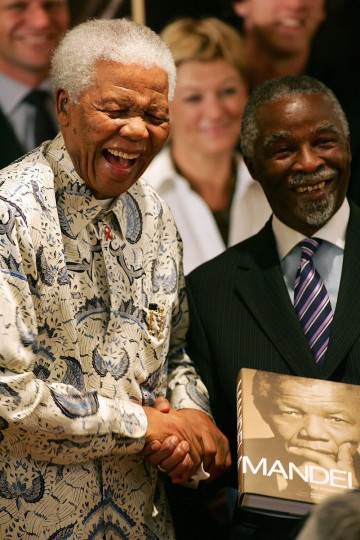 South Africa's first black President Nelson Mandela (L) and South African President Thabo Mbeki (R) joke on October 9, 2006 in Johannesburg at the launch of the new book Mandela: The Authorised Portrait. (Alexander Joel/AFP/Getty Images)