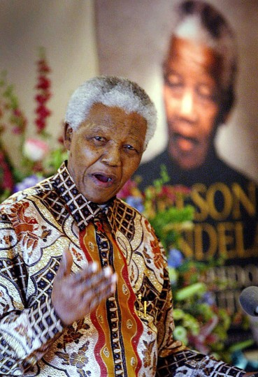 Former South African President Nelson Mandela speaks to journalists and dignitaries at the Mandela Foundation in Johannesburg after being given a book to mark his 85 birthday on 17 July 2003. (Alexander Joel/AFP/Getty Images)