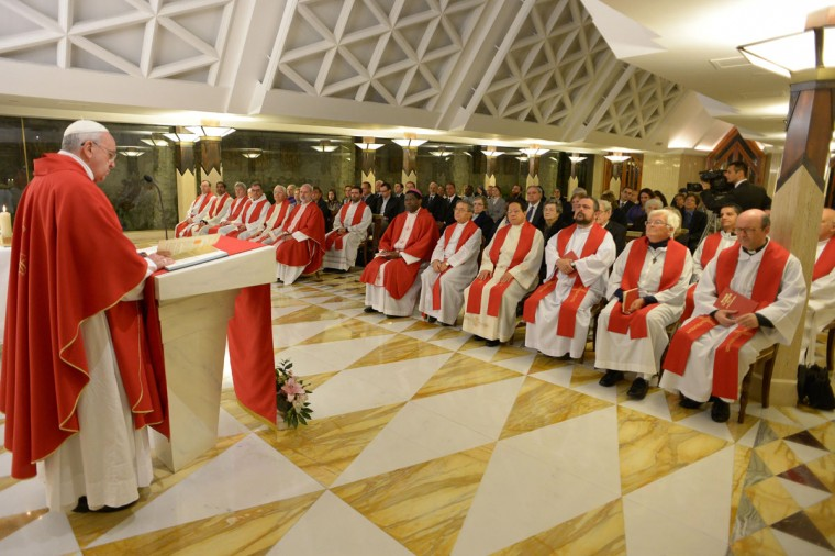 This handout picture released on October 17, 2013 by the Vatican press office shows Pope Francis (L) leading a mass at the Santa Marta church at the Vatican. (Observatore Romano/AFP/Getty Images)
