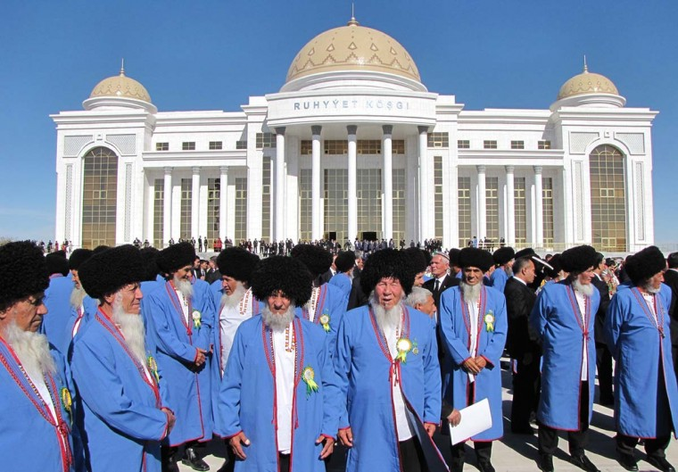 Wearing their traditional costumes Turkmen elders gather for their meeting in this October file photo. Turkmenistan is scheduled on December 15 to elect representatives in its national assembly.
