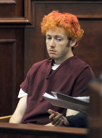 "James Holmes appears in court at the Arapahoe County Justice Center in this July 23, 2012 file photo in Centennial, Colorado. A US judge on November 21, 2013 indefinitely postponed a planned February start date for the trial of James Holmes, accused of killing 12 people in a massacre at a Colorado movie theater last year. Judge Carlos Samour ordered the delay after prosecutors called for alleged gunman James Holmes to undergo another mental evaluation to determine whether he was insane at the time of the mass shooting in July last year. ""I'm not going to rush through any issue,"" the Arapahoe County District Court judge said, scheduling new hearings in the case for December 17-18 according to the Denver Post. ""I want to give every (legal) motion as much attention as they deserve,"" the newspaper cited him as saying. Holmes is accused of killing 12 people and wounding 70 people when he allegedly opened fire last July in a packed midnight screening of the Batman movie ""The Dark Knight Rises"" in the Colorado town of Aurora, outside Denver. RJ SANGOSTI - AFP/Getty Images"
