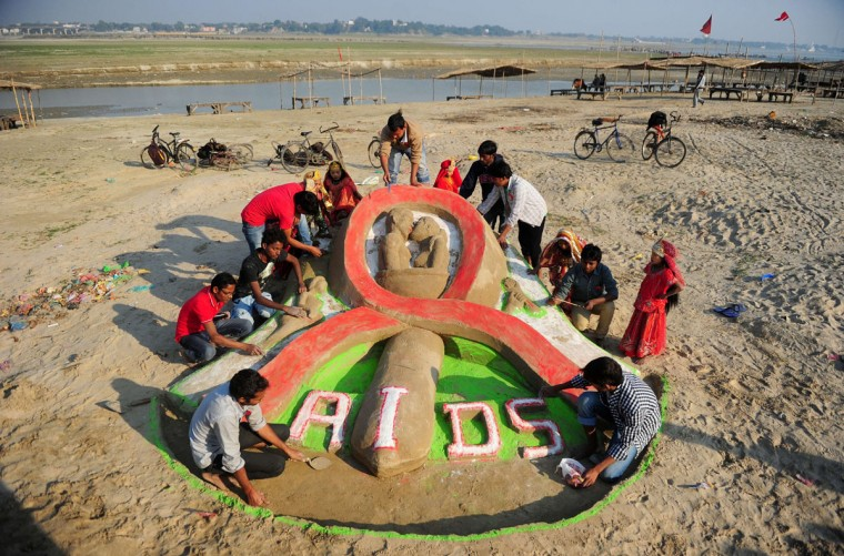 Indian fine arts students from Allahabad University make a sand sculpture to highlight AIDS awareness on the eve of World AIDS Day at Sangam in Allahabad, India on November 30, 2013. (Sanjay Kanojia/AFP/Getty Images)
