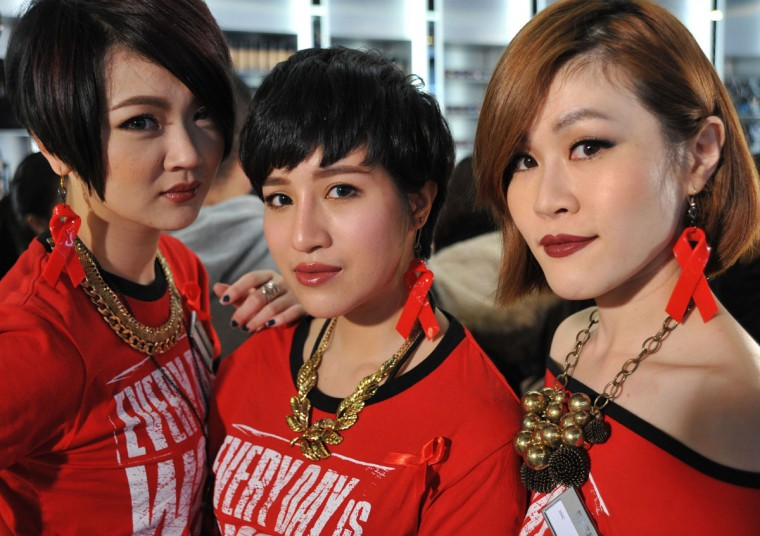 Three makeup artists wear red ribbon earrings during a press conference at World AIDS Day in Taipei on December 1, 2013. (Mandy Cheng/AFP/Getty Images)