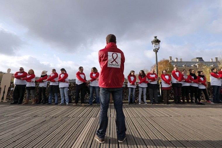 Activists form a chain of solidarity for World AIDS day on the Pont des Arts in Paris on December 1, 2013. (Francois Guillot/AFP/Getty Images)