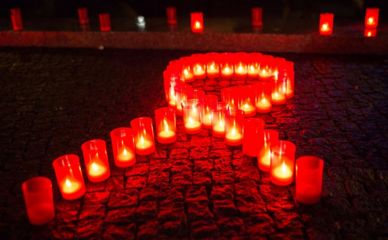 Candles form a red ribbon in Berlin, on November 30, 2013, the evening before World AIDS Day. (Florian Schuh/AFP/Getty Images)