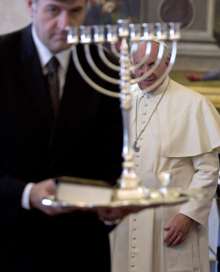 Pope Francis looks at a Menorah offered by Israeli Prime Minister Benjamin Netanyahu during a private audience at the Vatican, on December 2, 2013. (Alessandra Tarantino/AFP/Getty Images)