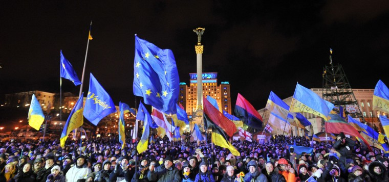 People shout slogans and wave Ukrainian and European Union flags during an opposition rally at Independence Square in Kiev on December 2, 2013. Tens of thousands have been protesting in Kiev, occupying City Hall and blocking entrances to the government headquarters, in an ongoing standoff after the government failed to sign a key EU pact. (Genya Savilov/AFP/Getty Images)