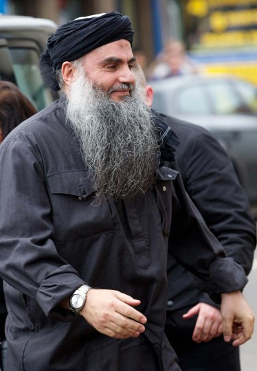 A picture taken on November 13, 2013 shows radical Islamist cleric Abu Qatada arriving at his home in northwest London after he was released from prison. Qatada, deported by Britain in July after a near decade-long legal battle, is to go on trial in Jordan on December 10, judicial sources said on December 3, 2013. AFP PHOTO / ANDREW COWIE