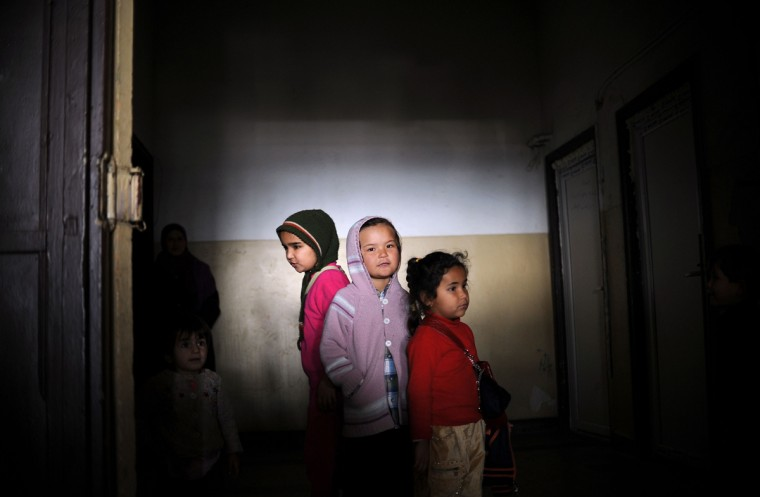Children wait to receive aid distributed by the Bulgarian Red Cross and the Medical University of Sofia at the recently opened Vrazhdebna refugee shelter in Sofia on December 3, 2013. Over 11,100 refugees, most of them Syrians, have entered Bulgaria illegally this year, crossing the porous 274-kilometre (170-mile) border with Turkey. (Nikolay Doychinov/AFP/Getty Images)