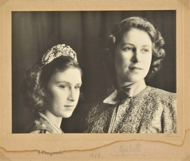 "A handout reproduction picture released by Dominic Winter Auctioneers on December 4, 2013 shows a signed photograph of the then Princess Elizabeth (R) (now Queen Elizabeth II) and Princess Margaret (L) in the play Aladdin at the Royal School in Windsor in 1943. A historic archive including over a dozen signed photographs relating to four Royal pantomimes produced at Windsor Castle during the second world war is expected to fetch over 16,000 GBP when it is auctioned in thirty-six lots by Dominic Winter Auctioneers in Gloucestershire on December 11, 2013. "" AFP PHOTO / DOMINIC WINTER AUCTIONEERS"