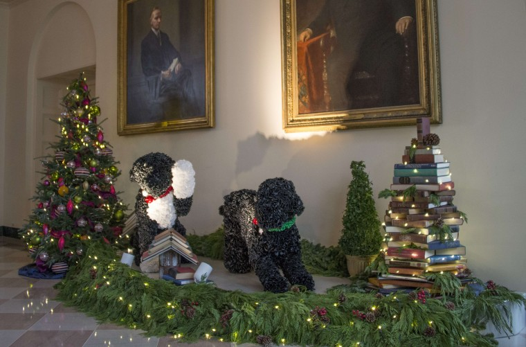 Decorations of the Obama's dogs Bo (L) and Sunny (R) are posed in the East Garden Room at the White House in Washington, DC, December 4, 2013 during the White House Christmas decorations viewing. (Jim Watson/AFP/Getty Images)