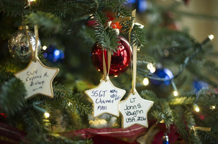 Ornaments placed by Gold Star families honoring members of the US military who made the ultimate sacrifice for their country hang on a tree in the East Entrance Landing at the White House in Washington, DC, December 4, 2013 during the White House Christmas decorations viewing. (Jim Watson/AFP/Getty Images)