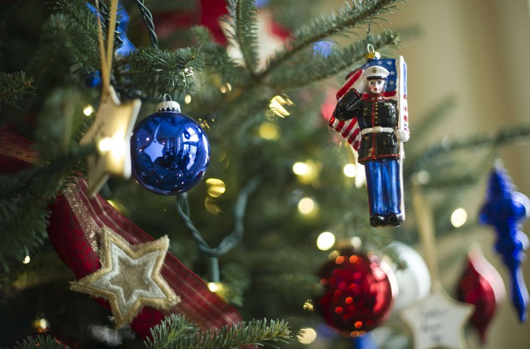 Ornaments honoring members of the US military who made the ultimate sacrifice for their country hang on a tree in the East Entrance Landing at the White House in Washington, DC, December 4, 2013 during the White House Christmas decorations viewing. (Jim Watson/AFP/Getty Images)