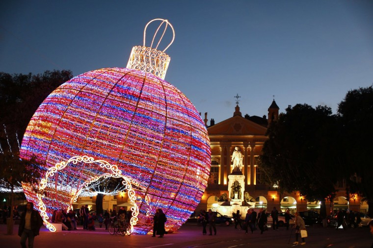 People walk by a giant christmas ball displayed in Nice, southeastern France. (VALERY HACHE / AFP/Getty Images)