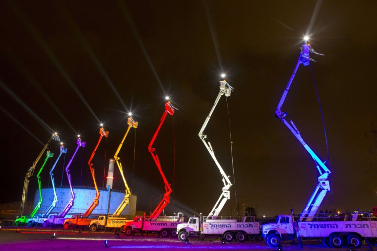 Israel Electric, the main supplier of electrical power in Israel, creates an interpretation of a Menorah using cranes, as they try to create the world's largest Menorah to celebrate Hannukah in the Mediterranean coastal city of Tel Aviv. (JACK GUEZ / AFP/Getty Images)