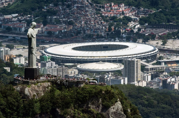 Aerial view of the Christ the Redeemer statue atop Corcovado Hill and the Mario Filho (Maracana) stadium in Rio de Janeiro, Brazil. (YASUYOSHI CHIBA / AFP/Getty Images)