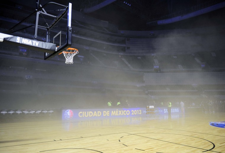 The Arena Ciudad de Mexico was evacuated before the Minnesota Timberwolves-San Antonio Spurs NBA game after a transformer burned and spread smoke on the court. (ALFREDO ESTRELLA / AFP/Getty Images)