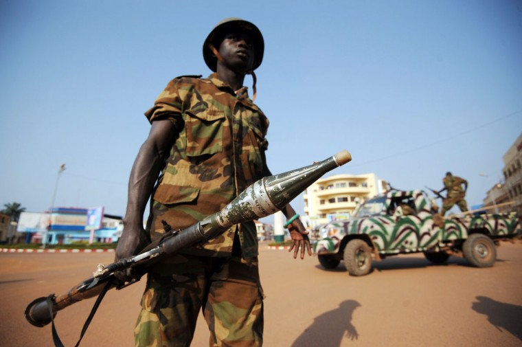 Soldiers patrol a street of Bangui as shots rang out and blasts from heavy weapons rocked several districts of the Central African capital amid communal tensions. (SIA KAMBOU / AFP/Getty Images