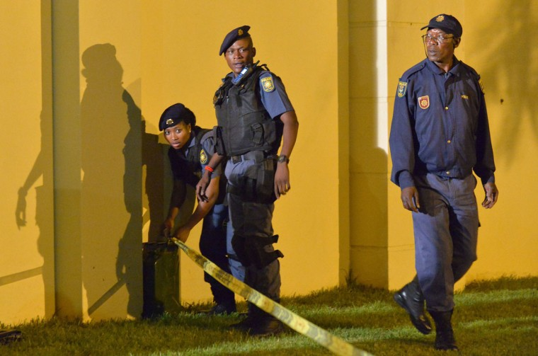 South African police set up a cordon outside the house of former South African president Nelson Mandela following his death in Johannesburg on December 5, 2013. Mandela, the revered icon of the anti-apartheid struggle in South Africa and one of the towering political figures of the 20th century, has died aged 95. Mandela, who was elected South Africa's first black president after spending nearly three decades in prison, had been receiving treatment for a lung infection at his Johannesburg home since September, after three months in hospital in a critical state. (Alexander Joe/AFP/Getty Images)