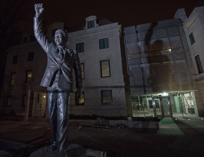 The newly installed statue of former South African President Nelson Mandela is seen in front of the South African Embassy on December 5, 2013, in Washington, DC. Mandela succumbed to a recurrent lung infection on Thursday. He was 95. (Paul J. Richards/AFP/Getty Images)