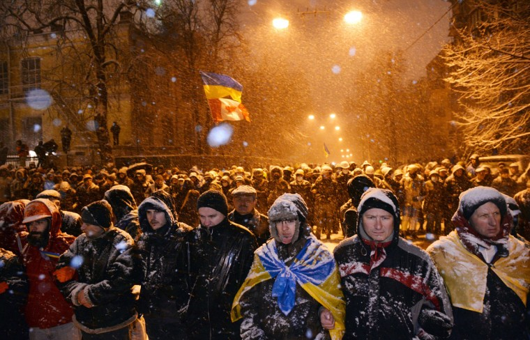 Pro-EU protesters face riot police in front of the government headquarters in Kiev on December 9, 2013. Hundreds of thousands had the day before, filled Independence Square to bursting point to denounce President Yanukovych's rejection of an EU pact under Kremlin pressure, in the biggest protests since the 2004 Orange Revolution. (Sergei Supinsky/AFP/Getty Images)
