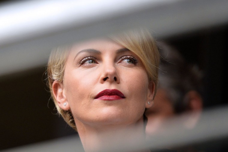 South African actress Charlize Theron attends the memorial service of South African former president Nelson Mandela at the FNB Stadium (Soccer City) in Johannesburg on December 10, 2013. Mandela, the revered icon of the anti-apartheid struggle in South Africa and one of the towering political figures of the 20th century, died in Johannesburg on December 5 at age 95. (Odd Andersen/AFP/Getty Images)