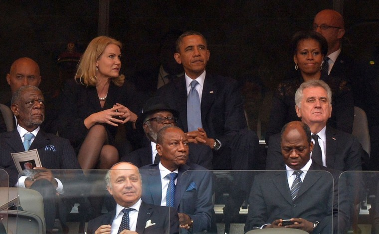 Danish Prime Minister Helle Thorning-Schmidt, U.S. President Barack Obama and First Lady Michelle Obama attend the memorial service for late South African President Nelson Mandela at Soccer City Stadium in Johannesburg on December 10, 2013. Mandela, the revered icon of the anti-apartheid struggle in South Africa and one of the towering political figures of the 20th century, died in Johannesburg on December 5 at age 95. (Alexander Joe/AFP/Getty Images)