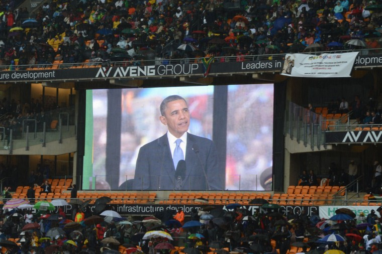 A giant screen shows U.S. President Barack Obama delivering a speech during the memorial service for late South African President Nelson Mandela at Soccer City Stadium in Johannesburg on December 10, 2013. Mandela, the revered icon of the anti-apartheid struggle in South Africa and one of the towering political figures of the 20th century, died in Johannesburg on December 5 at age 95. (Roberto Schmidt/AFP/Getty Images)