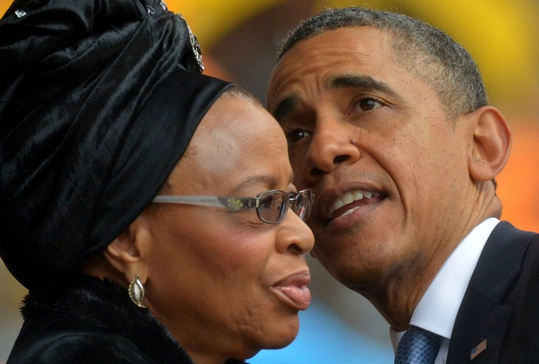 U.S. President Barack Obama talks with the widow of South African President Nelson Mandela, Graca Machel, during the memorial service for late South African President Nelson Mandela at Soccer City Stadium in Johannesburg on December 10, 2013. Mandela, the revered icon of the anti-apartheid struggle in South Africa and one of the towering political figures of the 20th century, died in Johannesburg on December 5 at age 95. (Alexander Joe/AFP/Getty Images)