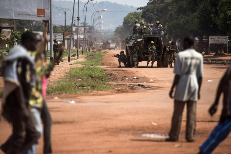 Troops of the multinational African force FOMAC take the control of a street in the Combattant Neighborood of Bangui on December 10, 2013. French President Francois Hollande was expected Tuesday in the Central African Republic, on the second day of an operation to disarm rogue rebels that has already killed two French soldiers. As the poverty-stricken country's former colonial master led the military effort to restore order after a year of chaos, Washington said it was offering to fly in African peacekeepers. (Fred Dufour/AFP/Getty Images)