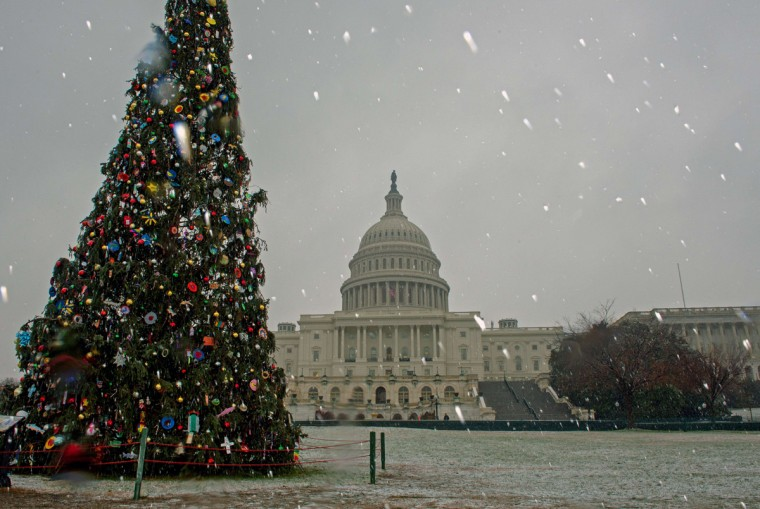 Light snow falls around the US Capitol, December 10, 2013, in Washington, DC. Snowfall in the northeastern United States caused flight cancellations and airport delays Tuesday while federal government offices and schools closed due to the foul weather. Major delays were reported at airports in Newark, New Jersey, as well as further south in Philadelphia, according to the FlightAware website.Snow and ice were also slowing air traffic at New York's LaGuardia and John F Kennedy International airports. (Paul J. Richards/AFP/Getty Images)