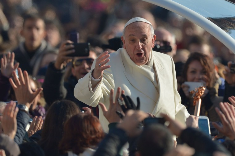 Pope Francis greets the crowd as he arrives for his general audience at St Peter's square on December 11, 2013 at the Vatican. (Vincenzo Pinto/AFP/Getty Images)