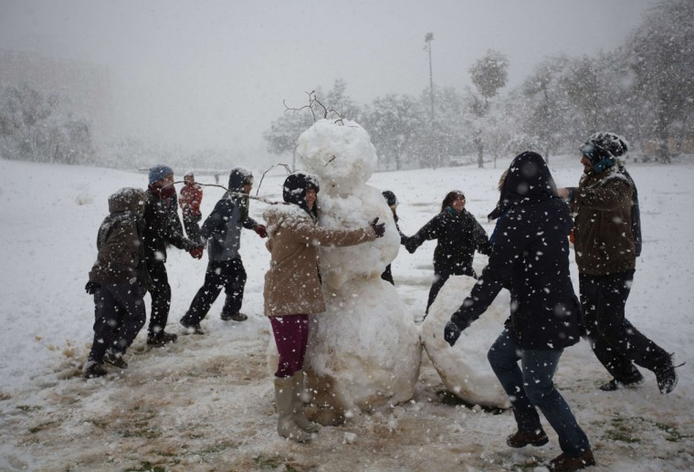 Israelis build a snowman as they enjoy the snow in Jerusalem on December 12, 2013. (MENAHEM KAHANA / AFP/Getty Images)