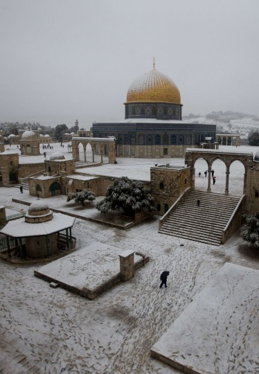 A general view shows the snow-covered Dome of the Rock at the Al-Aqsa mosque compound in the old city of Jerusalem on December 12, 2013. (AHMAD GHARABLI / AFP/Getty Images)