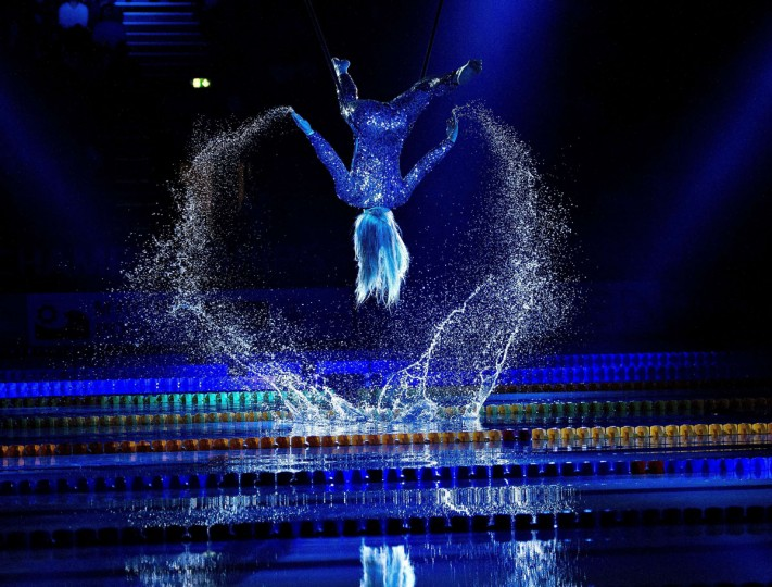 A woman performs at the opening ceremony of the Len European Short Course Swimming Championships in Herning, Denmark on December 12, 2013. (HENNING BAGGER / AFP/Getty Images)
