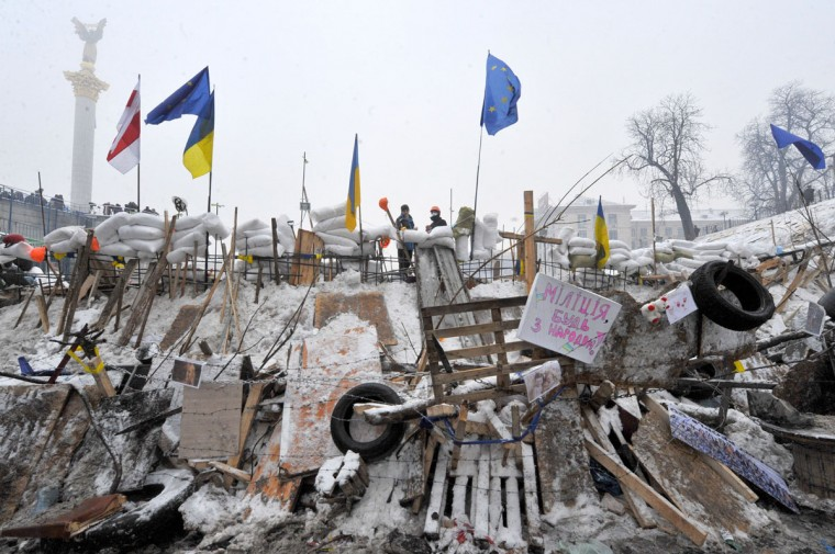 Protesters stand on a barricade on the Independence Square in Kiev on December 12, 2013. (VIKTOR DRACHEV / AFP/Getty Images)