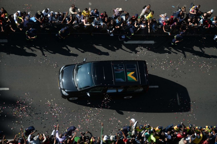 The coffin of South African former president Nelson Mandela is transported to the Union Buildings on the last day of his lying in state in Pretoria on December 13, 2013. (FILIPPO MONTEFORTE / AFP/Getty Images)