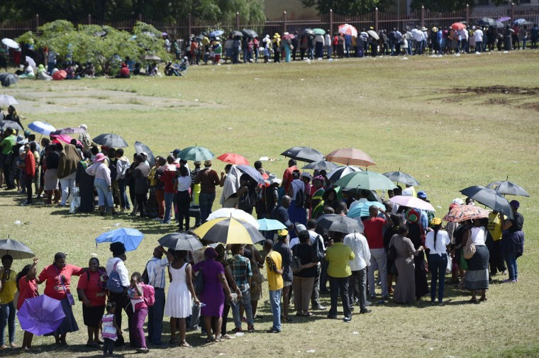People stand in line to pay their respect to South African former president Nelson Mandela on the last day of Mandela's lying in state at the Union Buildings in Pretoria on December 13, 2013. (STEPHANE DE SAKUTIN / AFP/Getty Images)