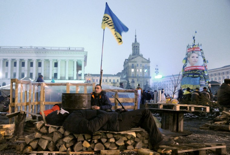 Protesters guard a barricade on Independence Square in Kiev late on December 12, 2013. (SERGEI SUPINSKY / AFP/Getty Images)
