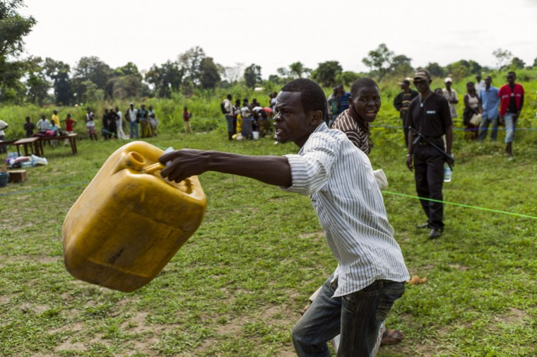 A man complains of insufficient food aid during an aid distribution by the UN World Food Program (WFP) near a camp for internally displaced persons (IDP) in Bangui on December 13, 2013. (FRED DUFOUR / AFP/Getty Images)