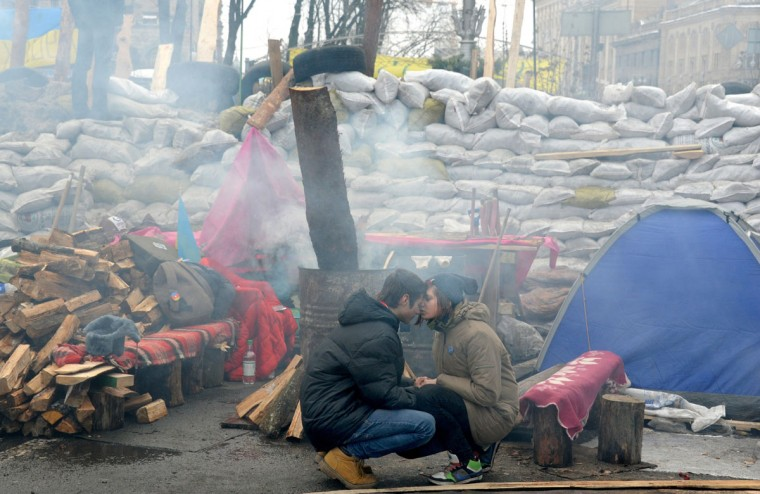 Young protesters wait at the barricade on Independence Square in Kiev on December 13, 2013. (VIKTOR DRACHEV / AFP/Getty Images)