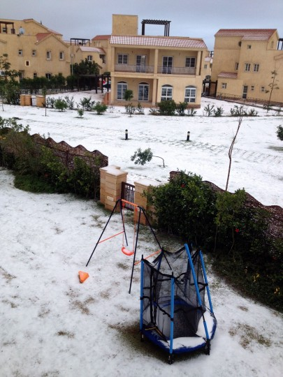 A picture shows snow in the Egyptian town of Madinaty, 40 kms east of Cairo, on December 13, 2013. A bruising winter storm brought severe weather to the Middle East, forcing the closure of roads and schools and blanketing already miserable Syrian refugee camps with snow. (Kareem Khirat/AFP/Getty Images)