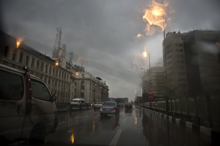 A picture taken through the windshield of a car shows Egyptians driving in the rain on December 13, 2013 in the capital Cairo. A regional cold snap spread to Egypt, with some Cairo suburbs seeing snowfall for the first time in years, a weather official said. (Khaled Desouki/AFP/Getty Images)