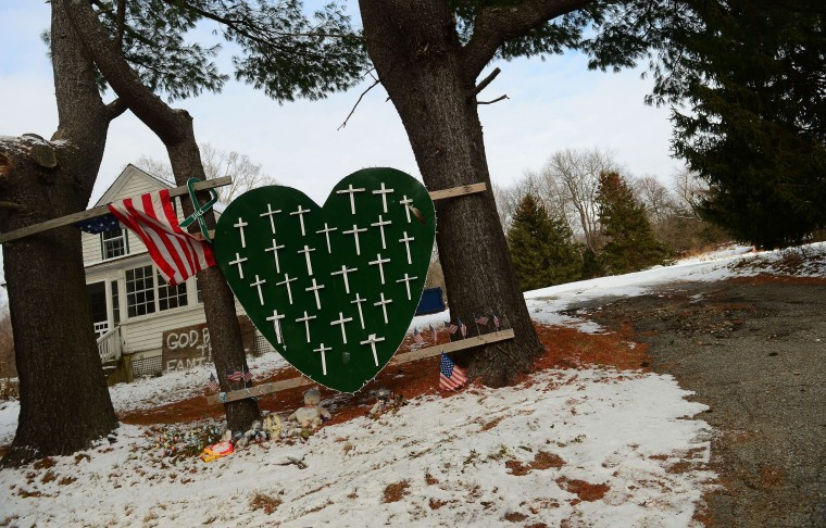 A memorial to victims of last year's Sandy Hook elementary school victims is seen in front of a house in Newtown, Connecticut, on December 13, 2013. Families ask media outlets to stay away in respect of their need to be alone to mark the one year anniversary, on December 14, during which 20-year-old gunman Adam Lanza went on a rampage at Sandy Hook elementary school, killing 20 children and six adults before turning a gun on himself. (Emmanuel Duand/AFP/Getty Images)