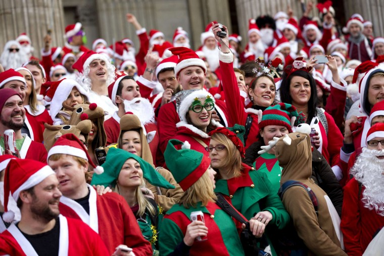 """Revellers in Santa costumes gather to take part in the annual """"Santacon"""" outside Saint Paul's Cathedral in central London on December 14, 2013. (Justin Tallis/AFP/Getty Images)"""