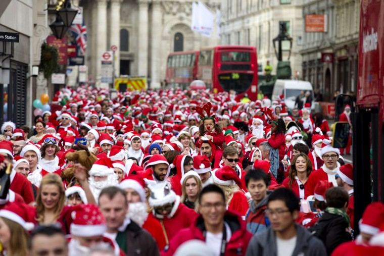 """Revellers in Santa costumes set of through the streets as they takes part in the annual """"Santacon"""" in central London on December 14, 2013. (Justin Tallis/AFP/Getty Images)"""