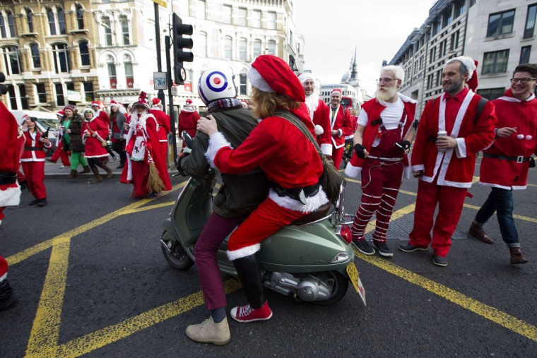"Revellers in Santa costumes set of through the streets as they takes part in the annual ""Santacon"" in central London on December 14, 2013. (Justin Tallis/AFP/Getty Images)"