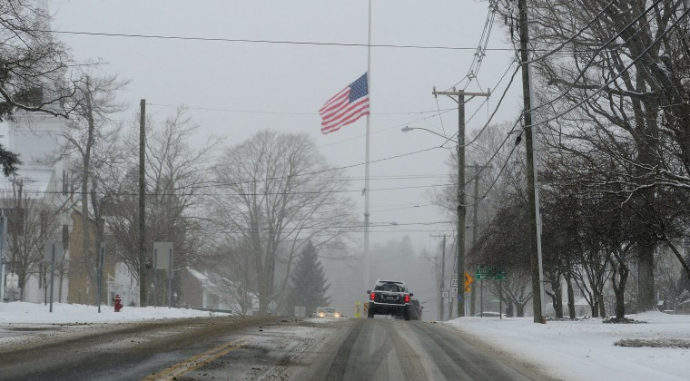 A flag is flown at half-mast to mark the one-year anniversary of Sandy Hook Elementary School shooting in Newtown, Connecticut, on December 14, 2013. Adam Lanza, 20, shot and killed 20 students and 6 teachers before shooting himself on December 14, 2012. (Emmanuel Duand/AFP/Getty Images)