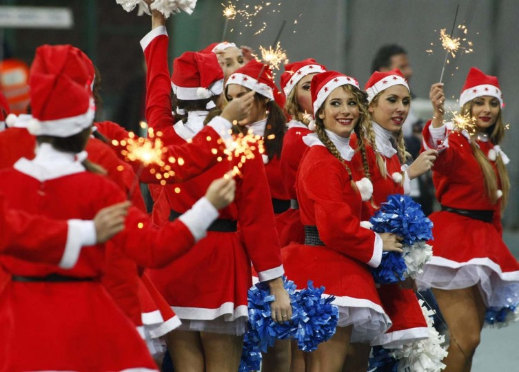 Napoli's cheerleaders dressed as Santa Klaus perform before the Italian Serie A football match SSC Napoli vs Inter Milan in San Paolo Stadium on December 15, 2013. (Carlo Herman/AFP/Getty Images)