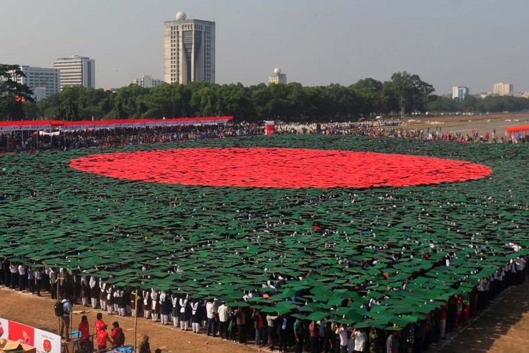 Bangladeshi participants form the worlds largest human national flag to mark the country's Victory Day in Dhaka on December 16, 2013. A total of 27,117 volunteers, mostly students, used coloured tiles to form the flag at Dhaka's National Parade Ground. Bangladesh won independence from Pakistan after a bitter nine-month war in 1971 led by the country's founder Sheikh Mujibur Rahman, which is celebrated every year on December 16.(Munir Uz Zaman/AFP/Getty Images )